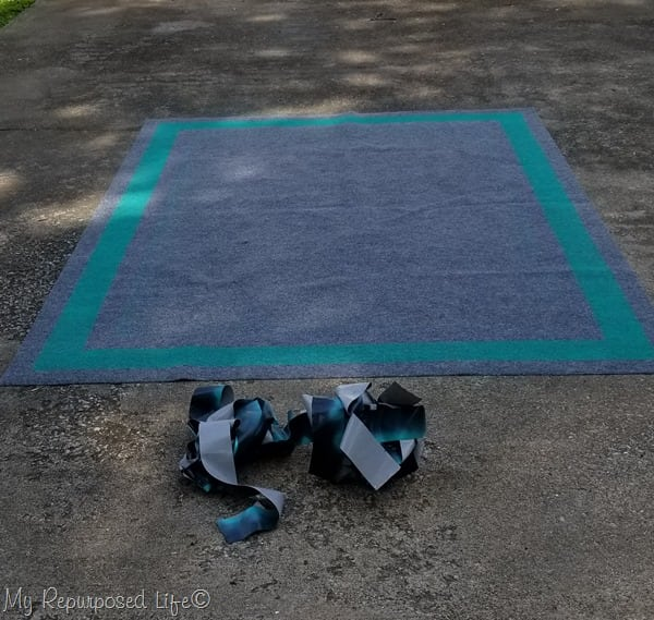 reveal new spay painted border outdoor rug