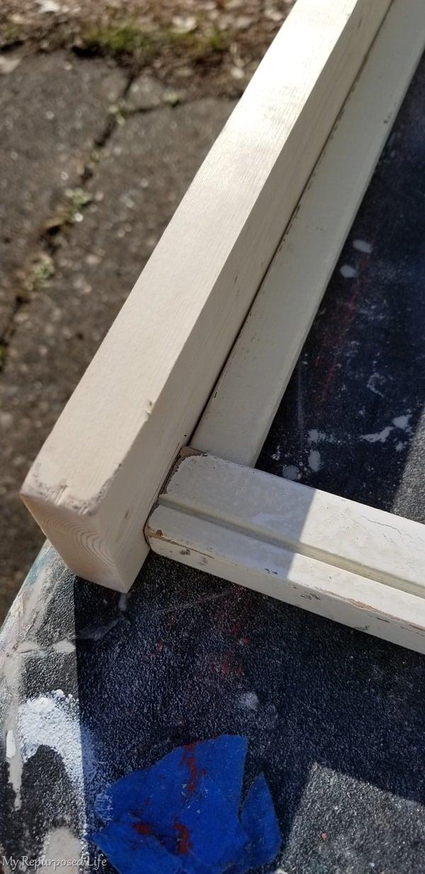 attach top shelf and bottom rail