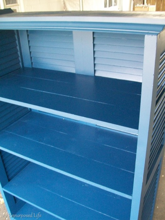 blue bookcase made from repurposed shutters