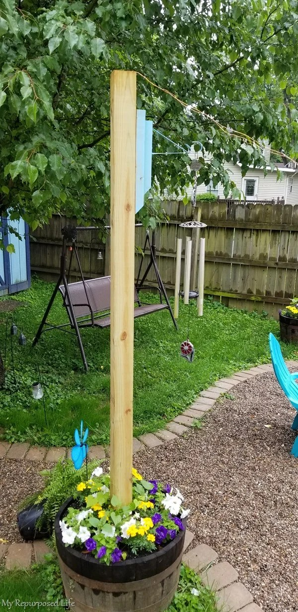 diy wooden brackets to hang wind chimes on 4x4 whiskey barrel planter post