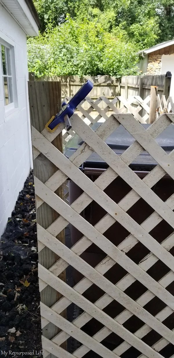 clamp aids in securing side panel of lattice
