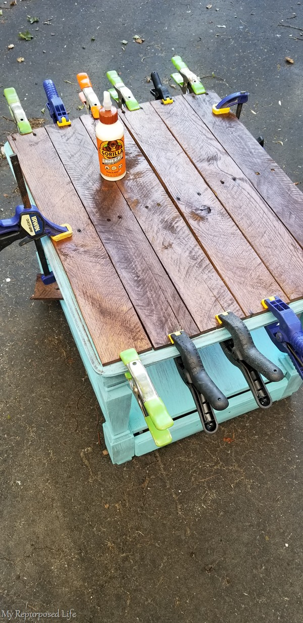 clamps hold table top in place until glue dries