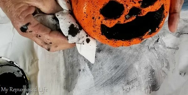 add black paint to inside of foam pumpkin jack-o-lantern