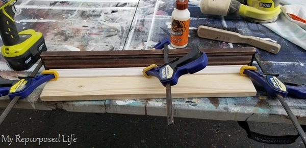 clamps and gorilla wood glue secure small trim