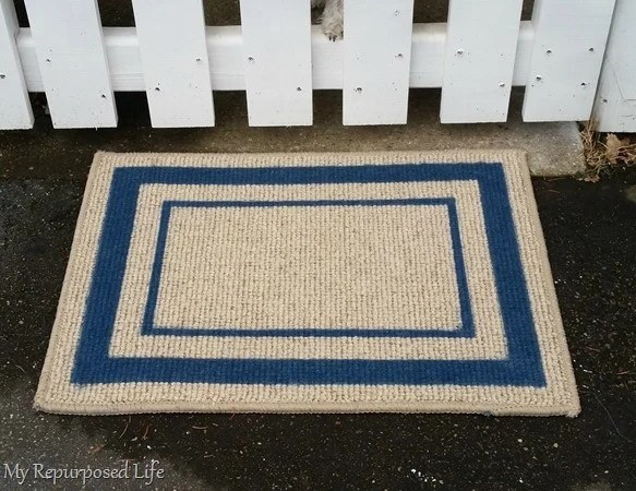 spray painted welcome mat