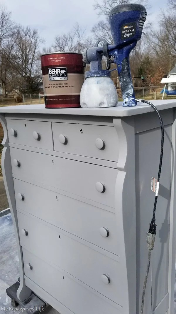 spray antique chest of drawers with topcoat of paint