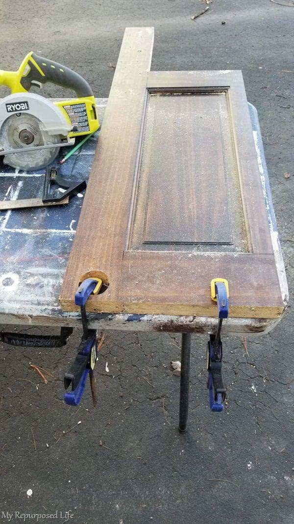 clamp door panel to work table