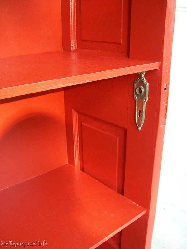 red repurposed door bookshelf