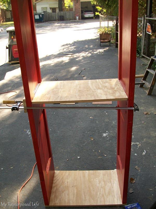 assembling a repurposed door bookshelf
