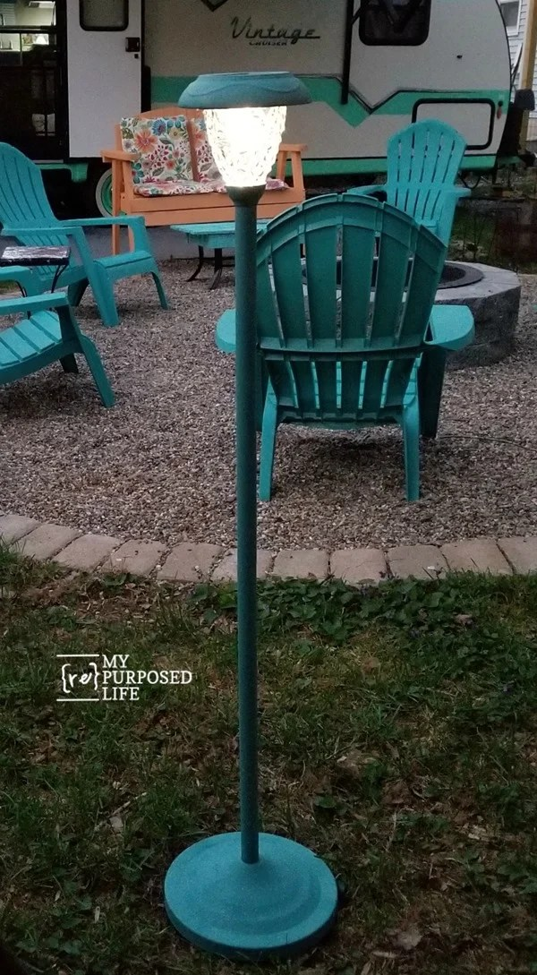 Do you love a good thrift store makeover? How about when it hangs around so long you get to update it again and again? That's the beauty of thrift store makeovers. Just add paint! This repurposed Floor Lamp Solar light is an easy project you can do in an afternoon. #MyRepurposedLife #Repurposed #floorlamp #solarlight #thriftstore  via @repurposedlife