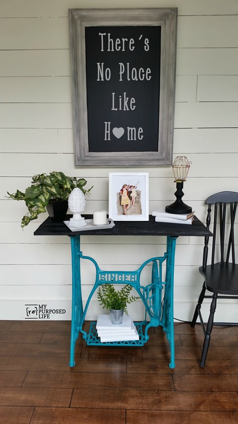How to make a sofa table or hall table out of a singer sewing machine. Tips on painting and adding a table top. This is not for your grandma's sewing machine. This machine was in very rough shape. #MyRepurposedLife #repurposed #furniture #singer #sewingmachine via @repurposedlife
