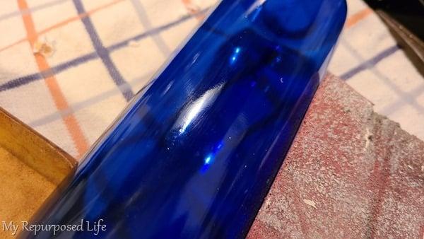 sand sticky residue off wine bottle