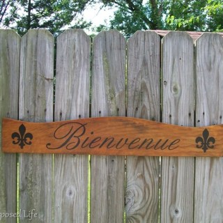 repurposed headboard sign bienvenue