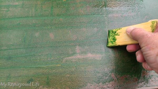 scrape green fuzz off of table