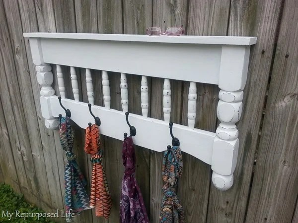 diy bed coat rack with scarves hanging from it