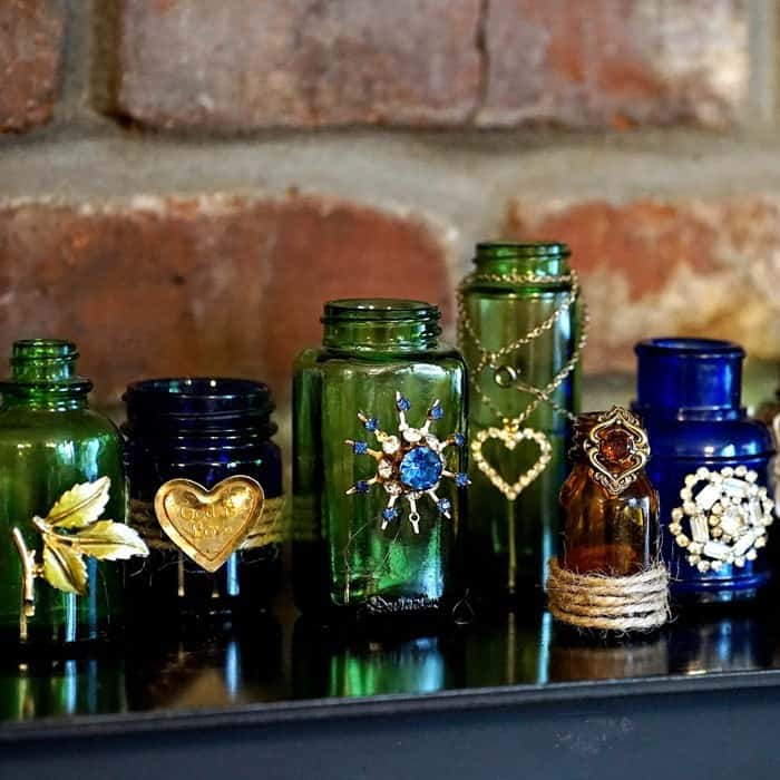 make some bottles with bling - vintage jewelry
