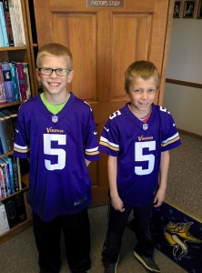 A couple brothers supporting their favorite football team and visiting Pastor Nick's office.