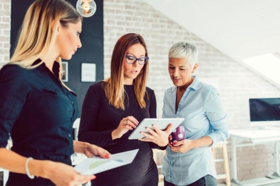 Three Women Looking at an iPad