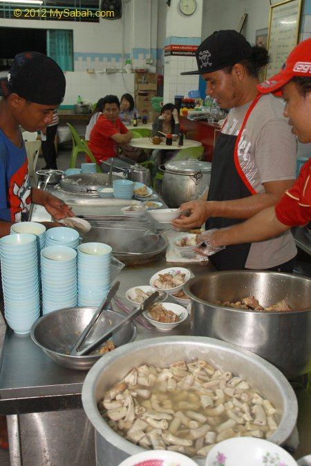 workers preparing Bak Kut Teh
