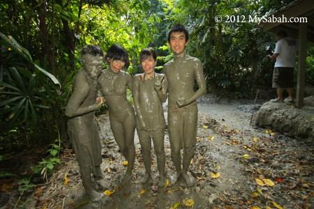 muddy tourists at mud volcano