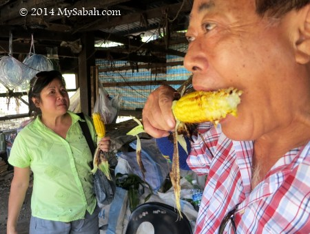 eating grilled corn