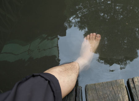 putting foot into water