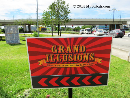 road signage of Grand Illusions