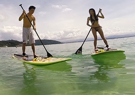 Stand Up Paddle Boarding on the sea of Sabah