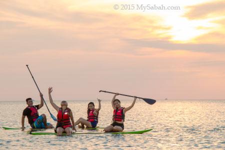 sunset group photo on standup paddleboard