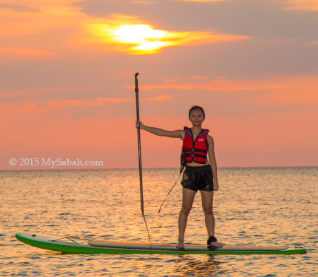 girl standing on Stand-up paddle-board