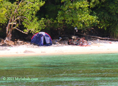 tourists camping on the beach