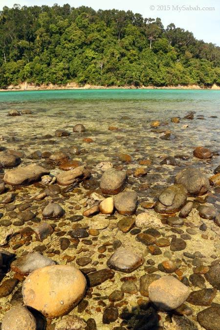 rocky beach of Pulau Sapi