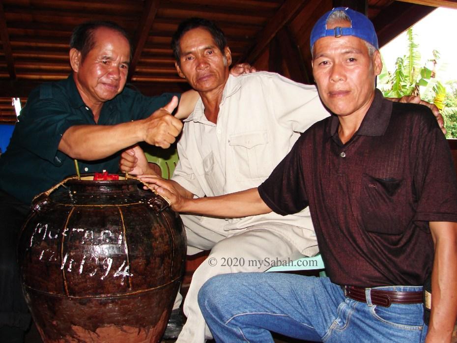 3 men next to Tapai wine jar