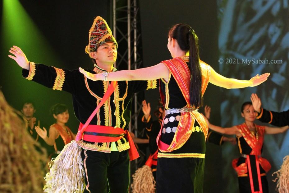 Kadazan male and female couple dancing Sumazau