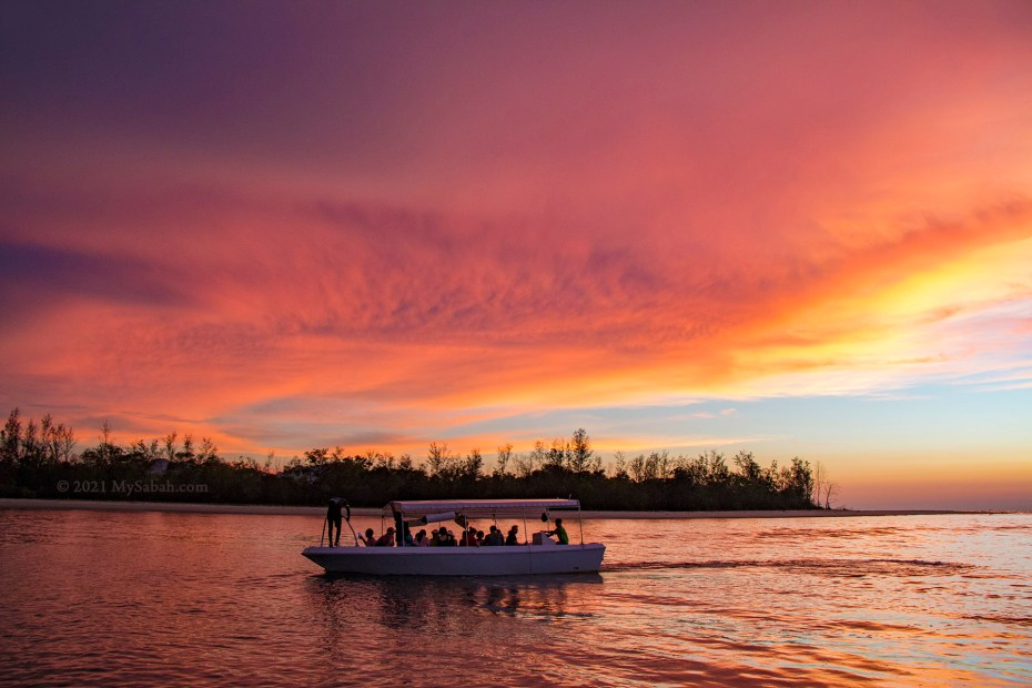 Fiery sunset at the river mouth of Mengkabong River