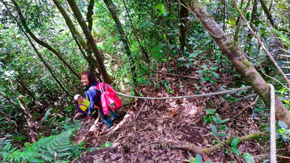 Two climbers on the descending route of loop trail of Maragang Hill