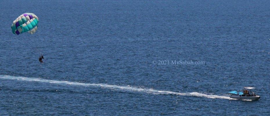 Parasailing in the sea of Tunku Abdul Rahman Park