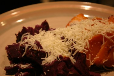 grated cheese on sweet potatoes