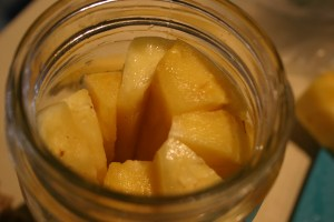 Fill the jar with pineapple wedges