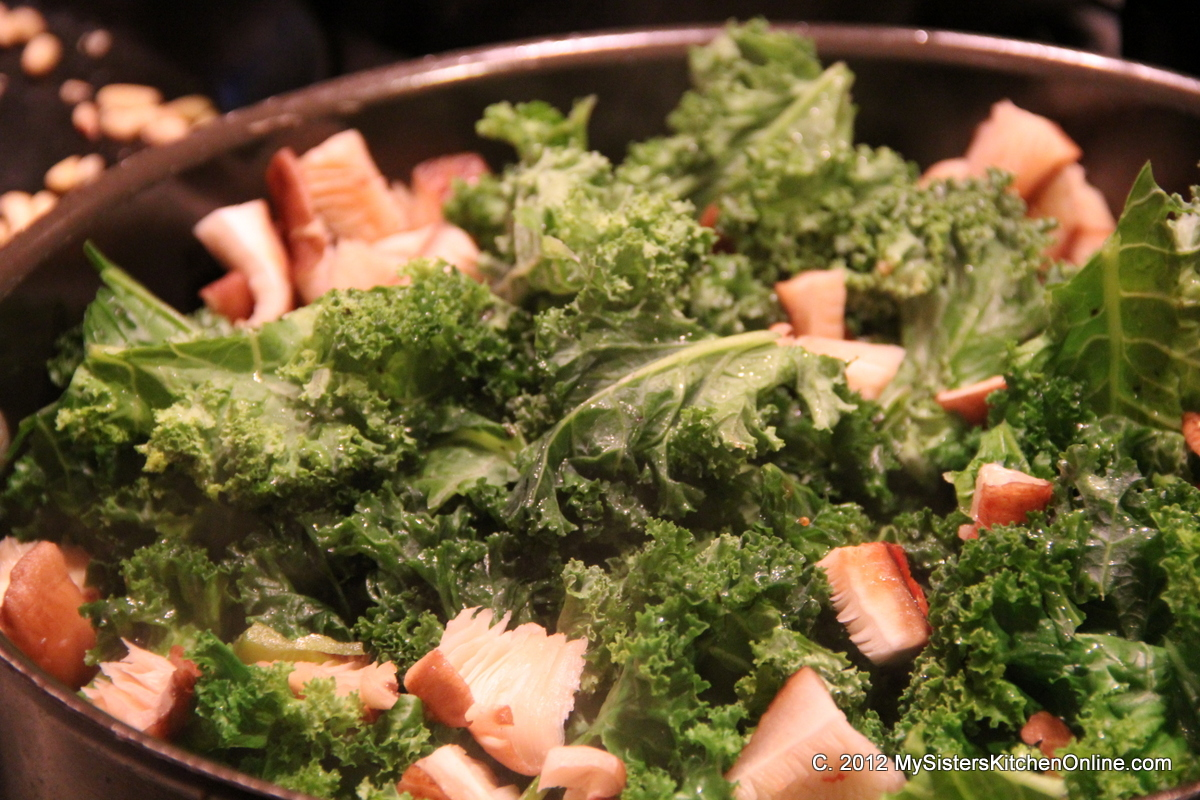 Saute mushrooms and kale for Kale with Garlic, Shrimp, and pine nuts