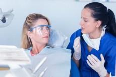 dentist explains to patient