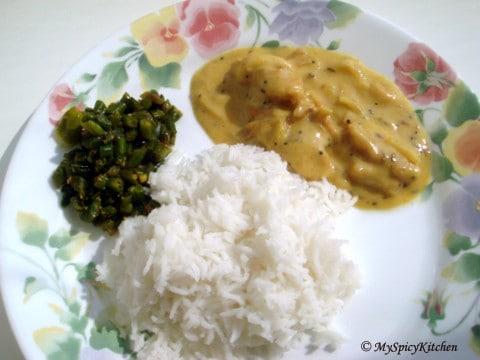 A plate of punjabi kadhi, rice & beans