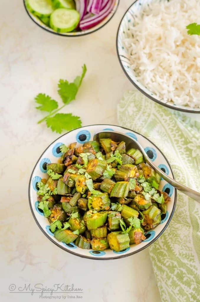 A bowl of Indian okra stir fry is an easy, everyday dry curry.  It is a great side dish for rice and flatbreads.