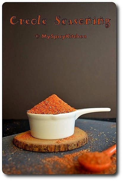 Creole Seasoning in a handled white cup