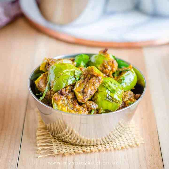 Bowl of green eggplant Indian dry curry with peanut sesame powder
