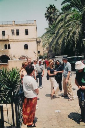 "Paivi Heinrich explains to the tour group where she lived along ""The Cardo"" in Old Jerusalem. It was one of several places where she lived during her ten years in Jerusalem."