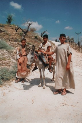 Two boys are dressed in authentic costume who normally perform various tasks at the re-created 1st century Nazareth Village, pose for this picture.