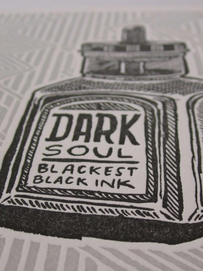 """Dark Soul"" letterpress art print detail photo showing the printing of black and grey inks up close"