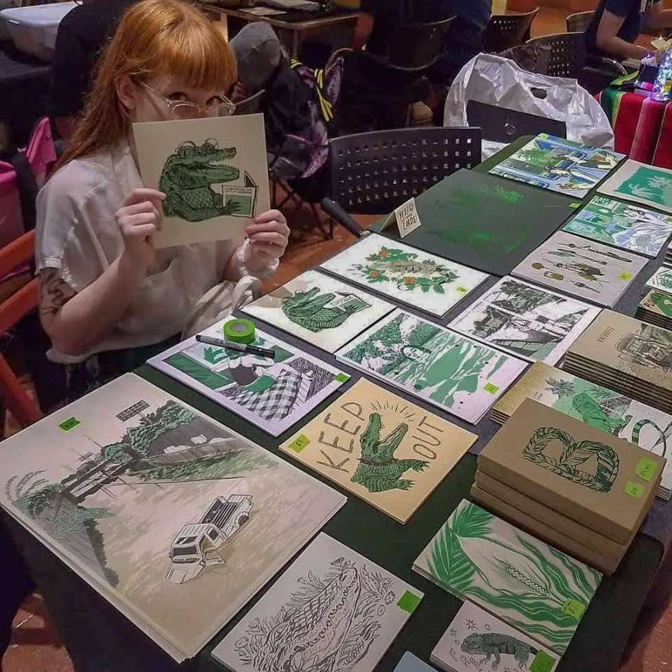 Photo of Sarah of Mystic Multiples selling prints at a table
