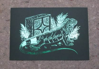Detail of crypt iguana print showing the illustration's reflection in the light due to the foil printing